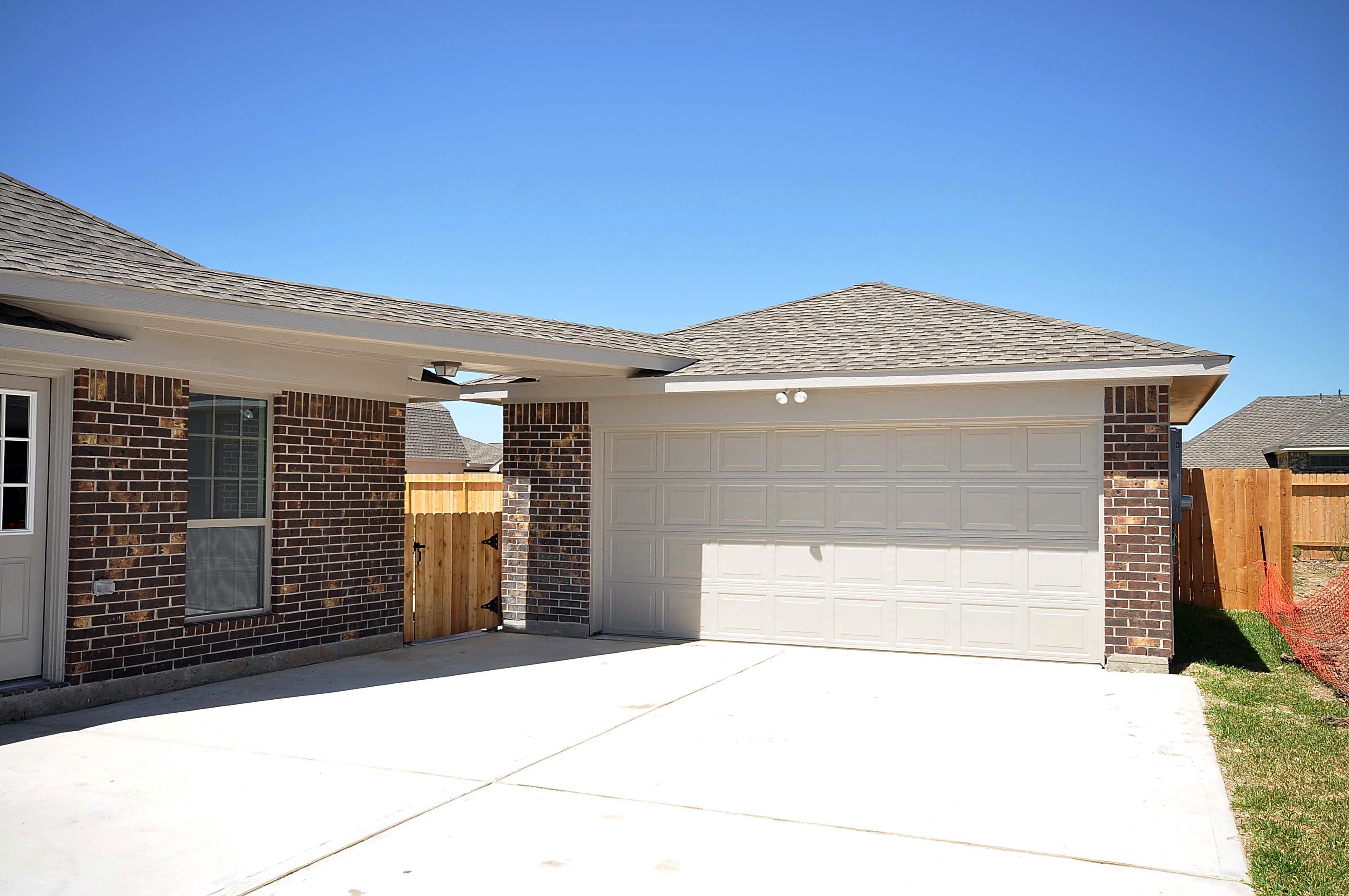 Cervelle homes standard 2 car garage for 1 1 2 car garage